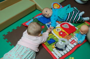 Photo: infants playing on foam mats